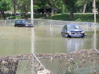 vehicles washed onto ball field.jpg
