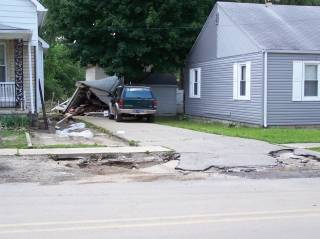 More damage from street to back.jpg